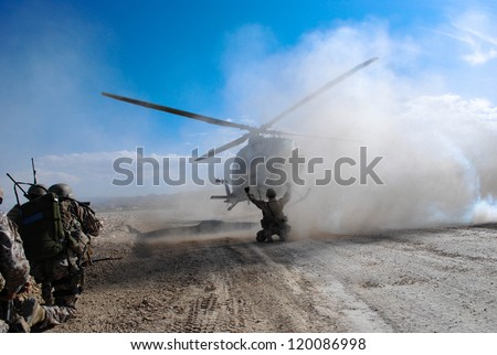 Soldiers in afghanistan - stock photo