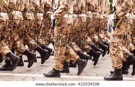 Soldiers in the form of khaki march in formation. Going from right to left - stock photo