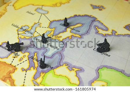 """Soldiers in war. Game on map """"Risk"""". - stock photo"""