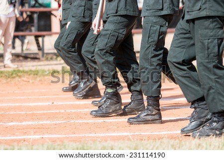 Soldiers march in formation  - stock photo