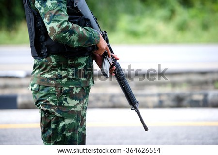 Soldiers stand with blurred forest background.  - stock photo