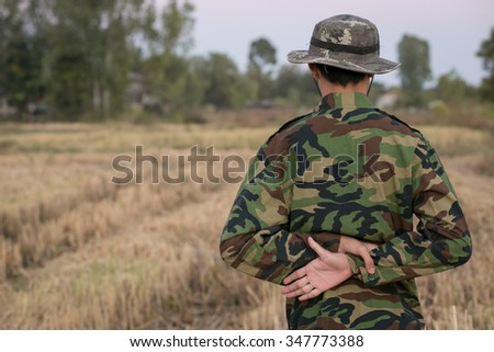 Soldiers standing posture by room - stock photo