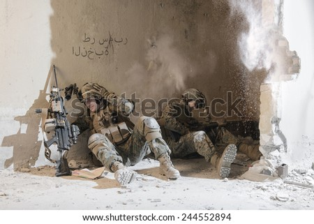 Soldiers under enemy fire. sudden attack. - stock photo