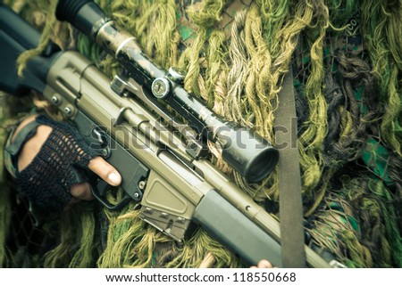 soldiers with assault rifle with telescopic view and camo suit - stock photo