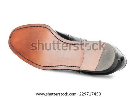 Sole of black man shoe isolated on white background.  - stock photo