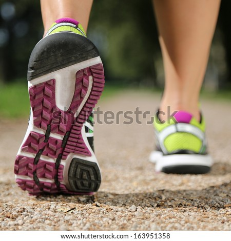Sole of running shoes while jogging, sport, training or workout - stock photo