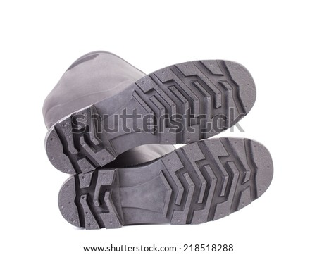 Sole side of rubber boot. Isolated on a white background. - stock photo