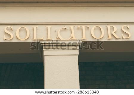 Solicitors sign conceptual image closeup - stock photo