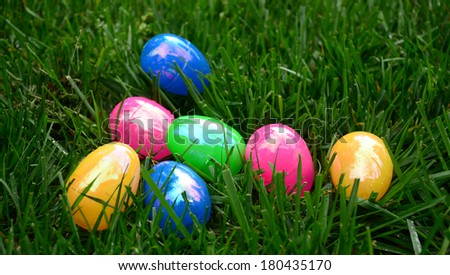 Solid color eggs on grass/Easter Egg Time/Multicolor eggs are lying on grass  - stock photo