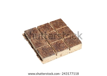 solid firelighter for barbeque isolated over white - stock photo