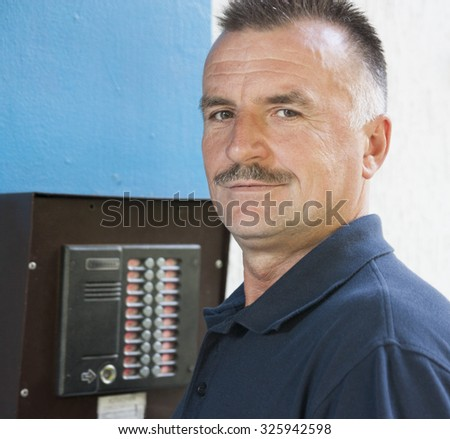 solid man in the street intercom repairs - stock photo