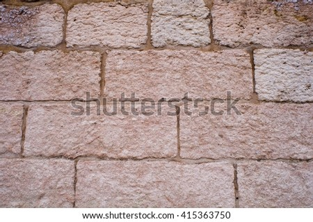 solid stone wall - stock photo