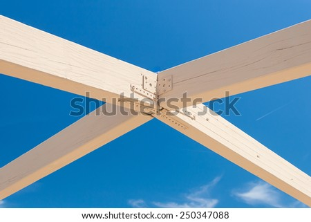 Solid Wooden beams against the blue sky - stock photo
