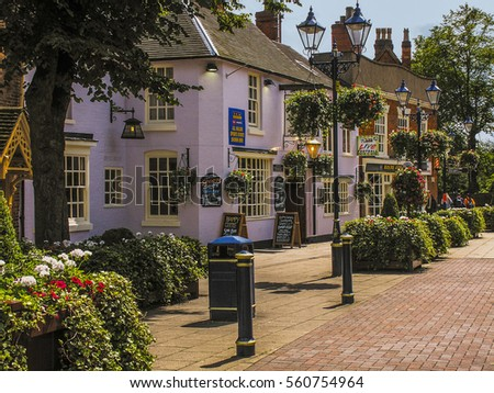 SOLIHULL WEST MIDLANDS  UK ?? SEPTEMBER 26 2016: Town centre of Solihull. Sunny afternoon in late September and there are people walking around the streets and pedestrianised squares of the town.