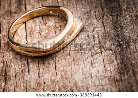 Solitaire engagement diamond ring on wooden organic background