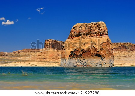 Solitary rock in the middle of lake powell - stock photo