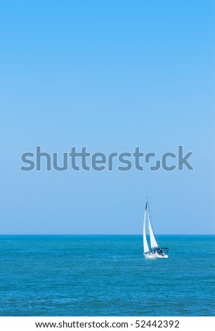 Solitary sailboat on Pacific Ocean on a sunny day.