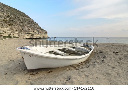 solitude boat in the sand of a beach in the South of Spain - stock photo
