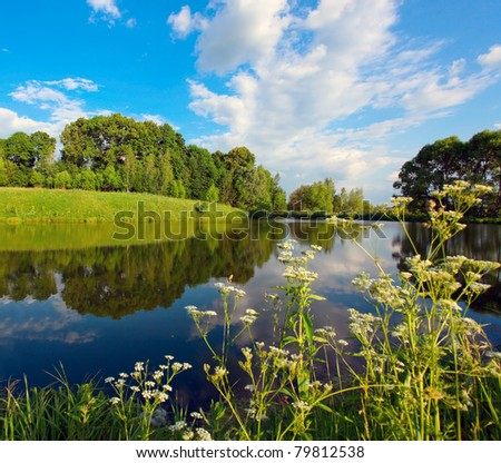 solitude scene of beautiful rural lake - stock photo