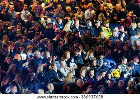 SOLNA, SWEDEN - MARCH 4, 2016: Closeup of the crowd at the Night of the jumps in Stockholm, Friends arena - stock photo