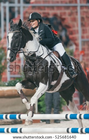 SOLNA, SWEDEN - NOV 24, 2016: Anna Book at the Celebrity jumping in the Sweden International Horse Show at Friends arena.