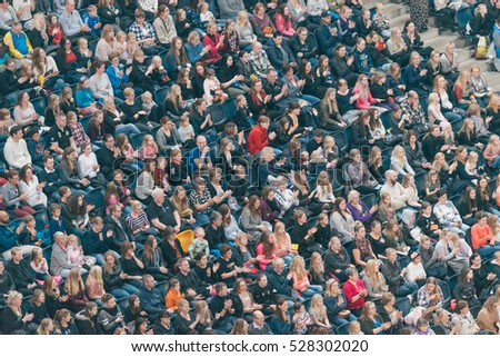SOLNA, SWEDEN - NOV 26, 2016: Spectators at the family matinee event in the Sweden International Horse Show at Friends arena.