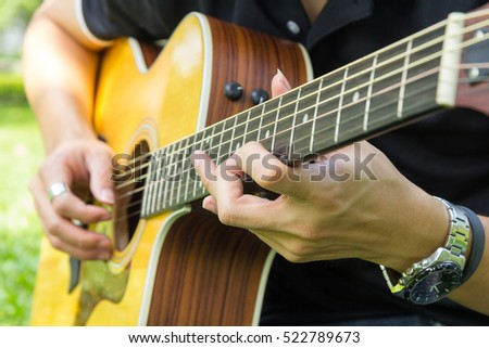 Solo acoustic guitar in the park