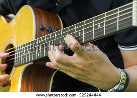 Solo acoustic guitar / playing guitar