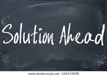 solution ahead text write on blackboard - stock photo