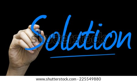 Solution hand writing with a blue mark on a transparent board - stock photo