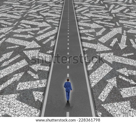 Solution path business concept as a businessman on a clear road cutting through confusing road arrows as a success direction metaphor for achievement and focus. - stock photo