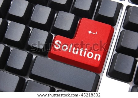 solution written on a computer keyboard enter button - stock photo