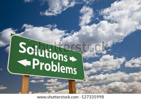 Solutions, Problems Green Road Sign Over Dramatic Clouds and Sky.
