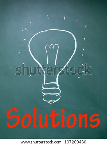 solutions title and bulb symbol - stock photo