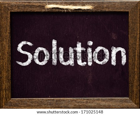 Solutions title on blackboard - stock photo