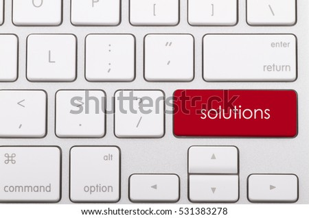 Solutions word written on computer keyboard.