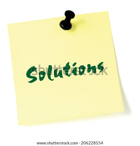 Solutions, written on a sticky adhesive note, isolated yellow post-it style sticker, black thumbtack pushpin, green text  - stock photo