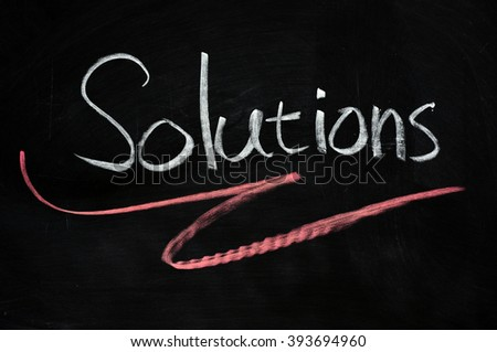 Solutions written with chalk on blackboard