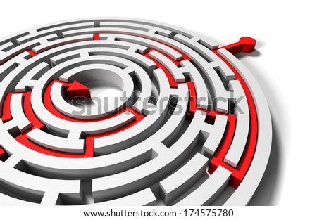 solved round labyrinth with red arrow in goal  - stock photo