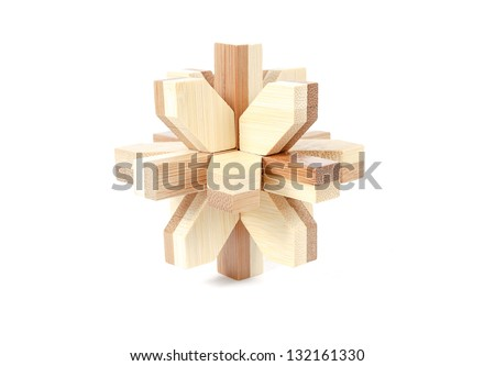 solved wooden puzzle isolated on white background - stock photo