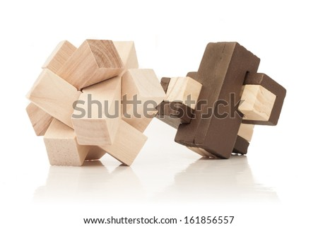 solved wooden puzzles isolated on white background