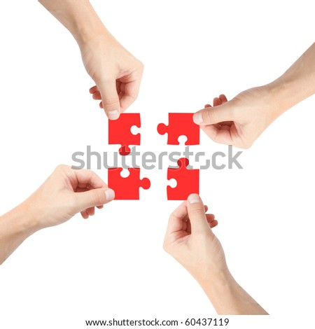 Solving a puzzle with teamwork - stock photo