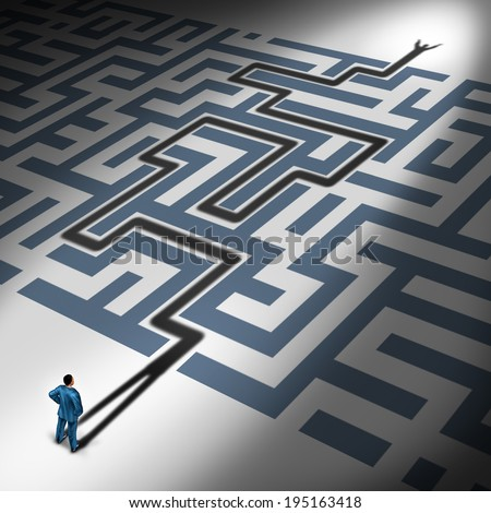Solving Problems and problem solver business concept as the cast shadow of a businessman navigating through a complicated maze to freedom as a financial metaphor for predicting the future. - stock photo