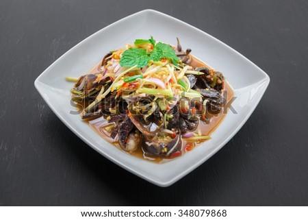 Som Tam (Spicy Papaya Salad) with salted crab  - stock photo