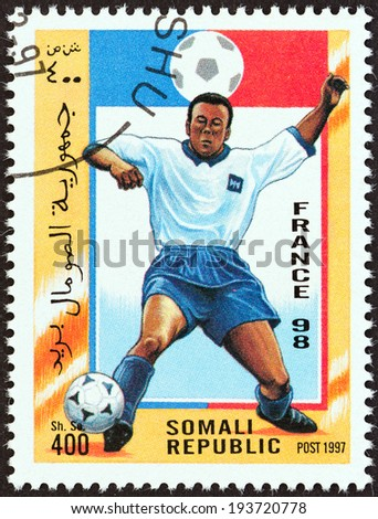 "SOMALIA - CIRCA 1997: A stamp printed in Somalia from the ""Football World Cup - France "" issue shows football player, circa 1997. - stock photo"