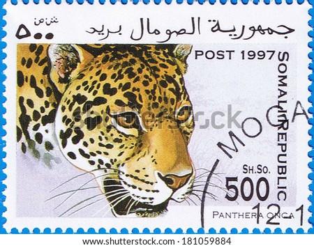 SOMALIA - CIRCA 1997: A stamp printed in Somalia shows a Jaguar (Panthera onca), circa 1997 - stock photo