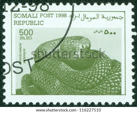 SOMALIA- CIRCA 1998: A Stamp printed in somalia shows the image of a snake, circa 1998 - stock photo