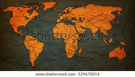 somalia flag on old vintage world map with national borders - stock photo