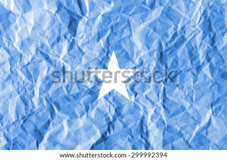 Somalia flag painted on crumpled paper background. - stock photo