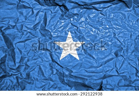 Somalia vintage flag on old crumpled paper background - stock photo